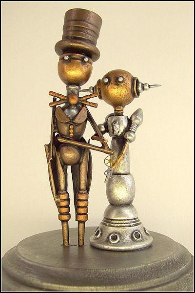 """figurki-dlya-svadby-stimpank Свадьба в стиле """"Стимпанк"""": роботы, шестеренки, гайки и болты в декоре"""