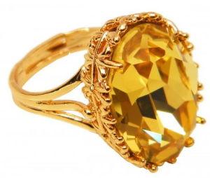 1365186504_zolotoe-kolco-s-zolotistym-topazom-300x254 Что символизируют камни в обручальных кольцах?